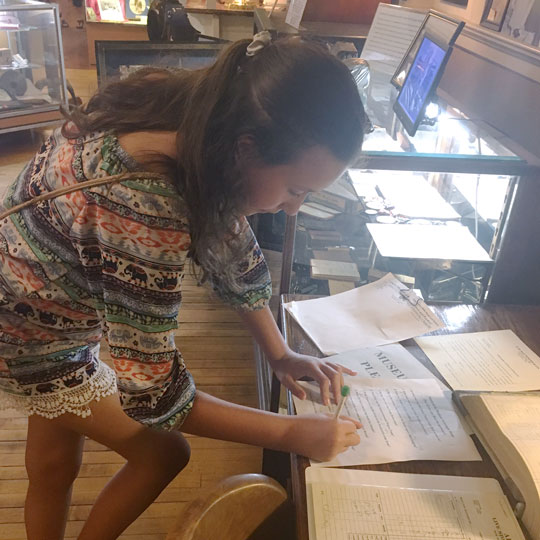 Lilah Galloway completes the Stockyards Museum scavenger hunt on her visit to Fort Worth.